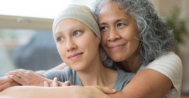 Mother Hugs Daughter Receiving Proper Cancer Treatment From Her Insurance
