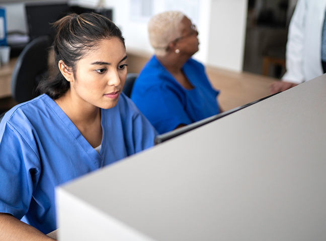 Healthcare provider working at a computer